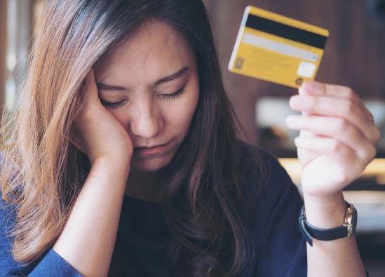 Person in Credit Card Debt